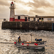 Cornish Fishing boat in the sunrise. Newlyn Harbour, Penzance, Newlyn Pier, sunrise.<br />