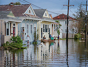 Nelson Street residents Lisa Burns and her sons Delton and DJ watch the water rise the day Hurricane Katrina hit New Orleans. The city slowly filled with water as dozens of flood protection walls began to crack and seep on August 29, 2005. <br />