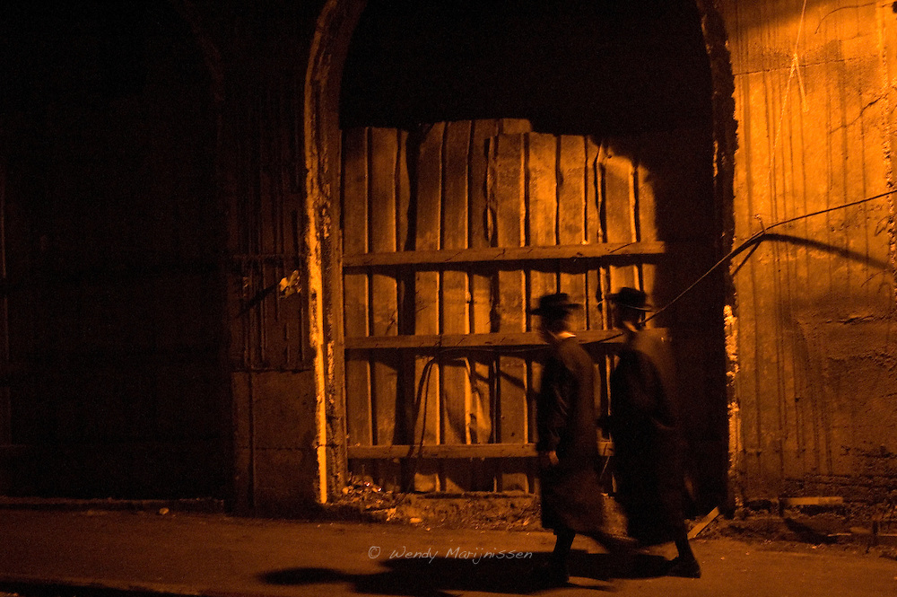 Two ultra orthodox Jewish men walk the streets of the Mea Shearim neighborhood. Jerusalem, Israel