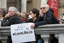 Trafalgar Square, London, June 22nd 2016. Thousands of people flood London's Trafalgar Square to celebrate what would have been slain Labour MP for Batley & Spen Jo Cox's 42nd birthhday. PICTURED: Somemmembers of the thousands-strong crowd adapted poster that were handed out with the #LoveLikeJo hashtag.