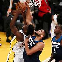 25 December 2017: Los Angeles Lakers forward Julius Randle (30) is blocked by Minnesota Timberwolves center Karl-Anthony Towns (32) during the Minnesota Timberwolves 121-104 victory over the LA Lakers, at the Staples Center, Los Angeles, California, USA.