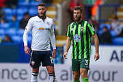 Bolton Wanderers striker Gary Madine (14)  and AFC Wimbledon defender Jonathan Meades (3)  during the EFL Sky Bet League 1 match between Bolton Wanderers and AFC Wimbledon at the Macron Stadium, Bolton, England on 4 March 2017. Photo by Simon Davies.
