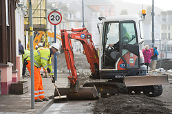 © London News Pictures. 07/01/2014. Aberystwyth, UK.<br /> Workmen begin the long process of clearing debris and damaged on the seafront at Aberystwyth, Wales, caused by a storm which battered the East coast of the UK and Ireland. Photo credit: Keith Morris/LNP