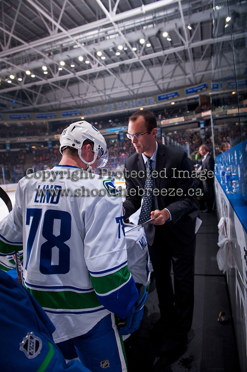 PENTICTON, CANADA - SEPTEMBER 8: Kole Lind #78 of Vancouver Canucks speaks to a coach on the bench during first period against the Winnipeg Jets on September 8, 2017 at the South Okanagan Event Centre in Penticton, British Columbia, Canada.  (Photo by Marissa Baecker/Shoot the Breeze)  *** Local Caption ***