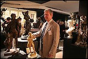 PETER COWLEY AT THE GARRET & HURST STAND at the preview of LAPADA Art and Antiques Fair. Berkeley Sq. London. 23 September 2014.