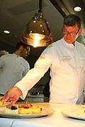Mannheim. 09.05.18 | <br /> Küchenparty im Sternerestaurant Opus V.<br /> Vorstellung des Radio Regenbogen Harald Wohlfahrt Palazzo Jubiläumsmenüs.<br /> 20 Jahre Palazzo und 18 Jahre unter der Küchenregie von Harald Wohlfahrt mit seinen innovativen und qualitativ hochwertigen Kreationen. Mittlerweile hat sich die Spielzeit wegen der großen Resonanz von sechs Wochen auf viereinhalb Monate verlängert.<br /> Harald Wohlfahrt stellt nun im  Sternerestaurant Opus V im Dachgeschoss des Hauses engelhorn mode das Menü für die neue Spielzeit vor.<br /> Als Vorspeise gibt es Anis gebeizter Lachs mit marinierten Belugalinsen auf Mango-Papaya-Chutney. Der zweite Gang. Ein Spieß von Garnele und Jakobsmuschel an einer leichten Curry Velouté und Cocobohnen. Es folgt als Hauptgang ein Duett von der Barberie Ente auf Rahmwirsing, eingelegten Backpflaumen und Kartoffelsoufflé. Krönender Abschluss des Jubiläumsmenüs ist eine Panna Cotta an exotischem Fruchtsalat mit Himbeerbiskuit und Mangosorbet.<br /> <br /> <br /> Bild: Markus Prosswitz 09MAY18 / masterpress (Bild ist honorarpflichtig - No Model Release!) <br /> BILD- ID 00249 |