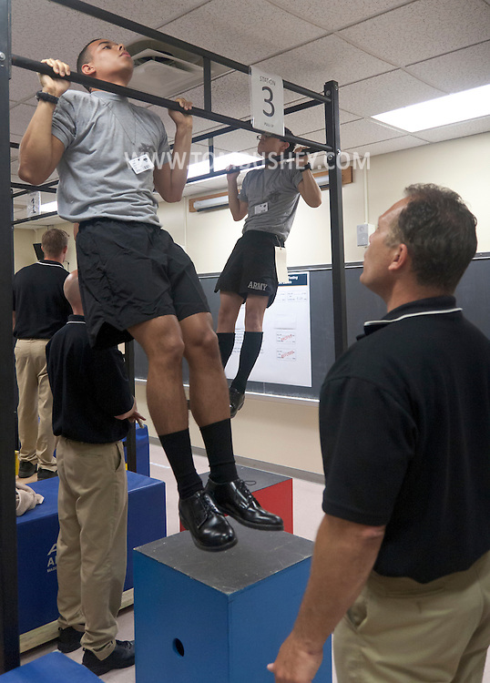 West Point, New York - New cadets do pull-ups as part of a physical evaluation during Reception Day at the United States Military Academy at West Point on July 2, 2014. About 1,200 cadet candidates, the West Point Class of 2018, reported to the academy to begin their military careers.
