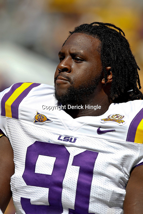 Oct 2, 2010; Baton Rouge, LA, USA; LSU Tigers defensive tackle Chris Davenport (91) on the field prior to kickoff of a game between the LSU Tigers and the Tennessee Volunteers at Tiger Stadium.  Mandatory Credit: Derick E. Hingle