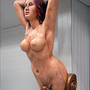 Folk Art Mermaid figurehead is a carved wooden decoration from the prow of ship  in Maritime Museum, FL.