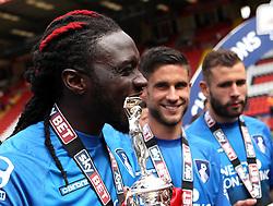 Bournemouth's Kenwyne Jones bits the top of the Sky Bet Championship trophy - Photo mandatory by-line: Robbie Stephenson/JMP - Mobile: 07966 386802 - 02/05/2015 - SPORT - Football - Charlton - The Valley - Charlton v AFC Bournemouth - Sky Bet Championsip