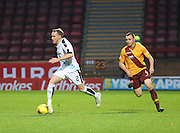 Dundee&rsquo;s Gary Irvine races away from Motherwell&rsquo;s Liam Grimshaw - Motherwell v Dundee - Ladbrokes Premiership at Fir Park<br /> <br /> <br />  - &copy; David Young - www.davidyoungphoto.co.uk - email: davidyoungphoto@gmail.com