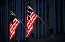 USA NEW YORK JUN10 - USA flags hang on a building on Wall Street in downtown Manhattan, New York...jre/Photo by Jiri Rezac..© Jiri Rezac 2010