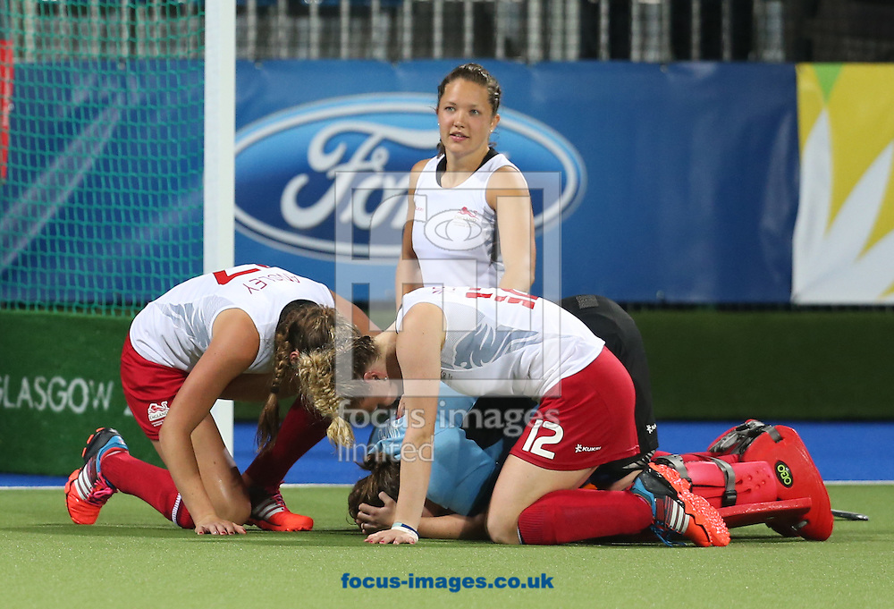 England Goalkeeper Maddie Hinch is consoled by her team mates after their defeat in the Women's final during day ten of the Hockey at Glasgow National Hockey Centre, during the Glasgow 2014 Commonwealth Games.<br /> Picture by Paul Terry/Focus Images Ltd +44 7545 642257<br /> 02/08/2014