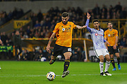 Patrick Cutrone of Wolverhampton Wanderers shoots at goal during the Europa League match between Wolverhampton Wanderers and Besiktas at Molineux, Wolverhampton, England on 12 December 2019.