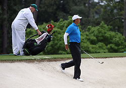 April 7, 2018 - Augusta, GA, USA - Tiger Woods enters a bunker on the 2nd hole during the third round of the Masters Tournament on Saturday, April 7, 2018, at Augusta National Golf Club in Augusta, Ga. (Credit Image: © Curtis Compton/TNS via ZUMA Wire)