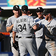 NEW YORK, NEW YORK - June 01:  Pitcher Matt Albers #34 of the Chicago White Sox is congratulated by team mates, from left, Jose Abreu #79, Todd Frazier #21, Tyler Saladino #18 and Brett Lawrie #15 of the Chicago White Sox after the team win in the thirteenth inning during the Chicago White Sox  Vs New York Mets regular season MLB game at Citi Field on June 01, 2016 in New York City. (Photo by Tim Clayton/Corbis via Getty Images)