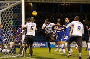 A scrappy goal line tussle ends in a much needed clearance from the Gillingham defence during the Sky Bet League 1 match between Gillingham and Bury at the MEMS Priestfield Stadium, Gillingham, England on 14 November 2015. Photo by Andy Walter.
