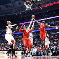 04 May 2011: Atlanta Hawks small forward Damien Wilkins (3) vies for the rebound with Chicago Bulls center Omer Asik (3) and Atlanta Hawks power forward Josh Smith (5) during the Chicago Bulls 86-73 victory over the Atlanta Hawks, during game 2 of the Eastern Conference semi finals at the United Center, Chicago, Illinois, USA.
