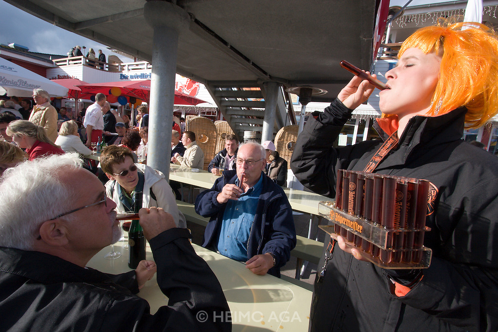 List harbour. Gosch - Germany's Northernmost fish restaurant. The Ja?germeister lady handing out free samples.