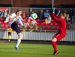 LLANELLI, WALES - Monday, August 19, 2013: England's Hannah Blundell in action against France's goalkeeper Solene Durand during the Group A match of the UEFA Women's Under-19 Championship Wales 2013 tournament at Stebonheath Park. (Pic by David Rawcliffe/Propaganda)