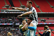 Millwall goalkeeper Jordan Archer (1) gives Millwall midfielder Calum Butcher (16) a piggy back after the EFL Sky Bet League 1 play off final match between Bradford City and Millwall at Wembley Stadium, London, England on 20 May 2017. Photo by Martin Cole.