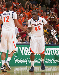 Virginia guard/forward Solomon Tat (45) celebrates with Virginia forward Jamil Tucker (12) during the VT game.  The Virginia Cavaliers defeated the Virginia Tech Hokies 75-61 at the John Paul Jones Arena on the Grounds of the University of Virginia in Charlottesville, VA on February 18, 2009.
