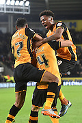 Hull City striker Chuba Akpom,Hull City midfielder Ahmed Elmohamady and Hull City defender Alex Bruce celebrate the gola by Hull City defender Alex Bruce during the Sky Bet Championship match between Hull City and Ipswich Town at the KC Stadium, Kingston upon Hull, England on 20 October 2015. Photo by Ian Lyall.