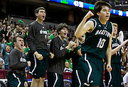 The Barstow Knights bench reacts after Jeriah Horne, not pictured, made a late three-pointer during Saturday's Class 3 Show-Me Showdown championship game against the Cardinal Ritter Lions at Mizzou Arena on March 15, 2014 in Columbia. (David Welker | Special to the Star)