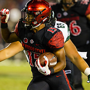24 November 2018: San Diego State Aztecs running back Jordan Byrd (15) rushes the ball on pitch play in the second quarter. The Aztecs closed out the season with a 31-30 overtime loss to Hawaii at SDCCU Stadium.