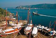 TURKEY, ISTANBUL,BOSPHORUS Ship building yards near Sariyer on the European shore; Anadolu Kavagi the Genovese castle c1350; on Asian shore