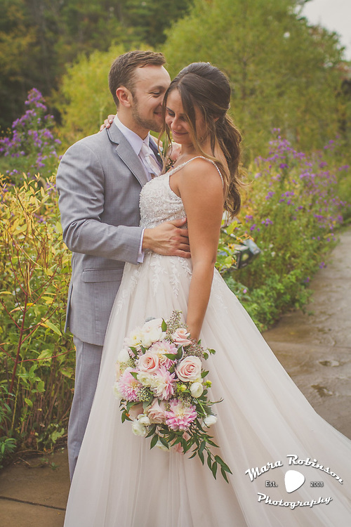 bride and groom in park by Tallmadge wedding photographer, Akron wedding photographer Mara Robinson Photography