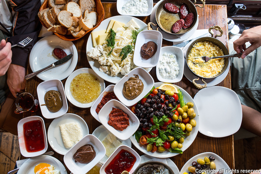 Van (eastern Turkey) - style breakfast ncludes murtaga, toasted wheat flour scrambled with eggs; a selection of cheeses (including otlu peyniri, Van sheep cheese flavored with pickled wild herbs); and kaymak (Turkish clotted cream) and honey. Istanbul, Turkey