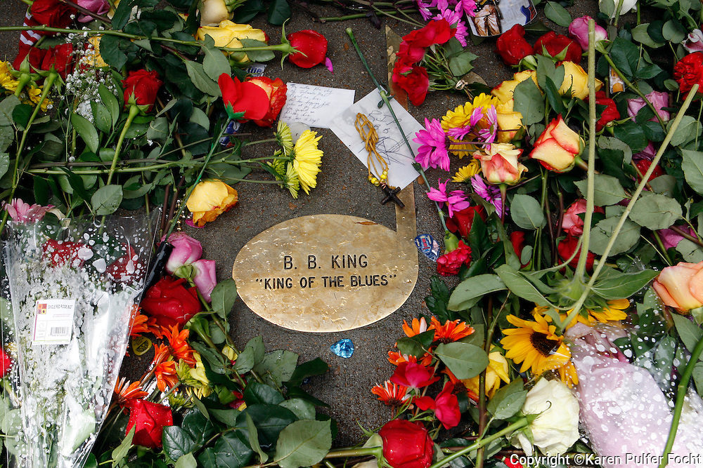Fans paid their respects to B.B. King outside of this Memphis Blues Club by laying flowers on the musical note dedicated to him on Beale Street in Memphis, Tennessee on Saturday. B.B. was a nick name given to him on Beale Street.  His nick name was Beale Street Blues Boy. The Mississippi-born legend died in his sleep at 11:40 p.m on Thursday night. King made a name for himself as a young man, as a blues artist on Beale Street in Memphis, where he later opened a name sake club.