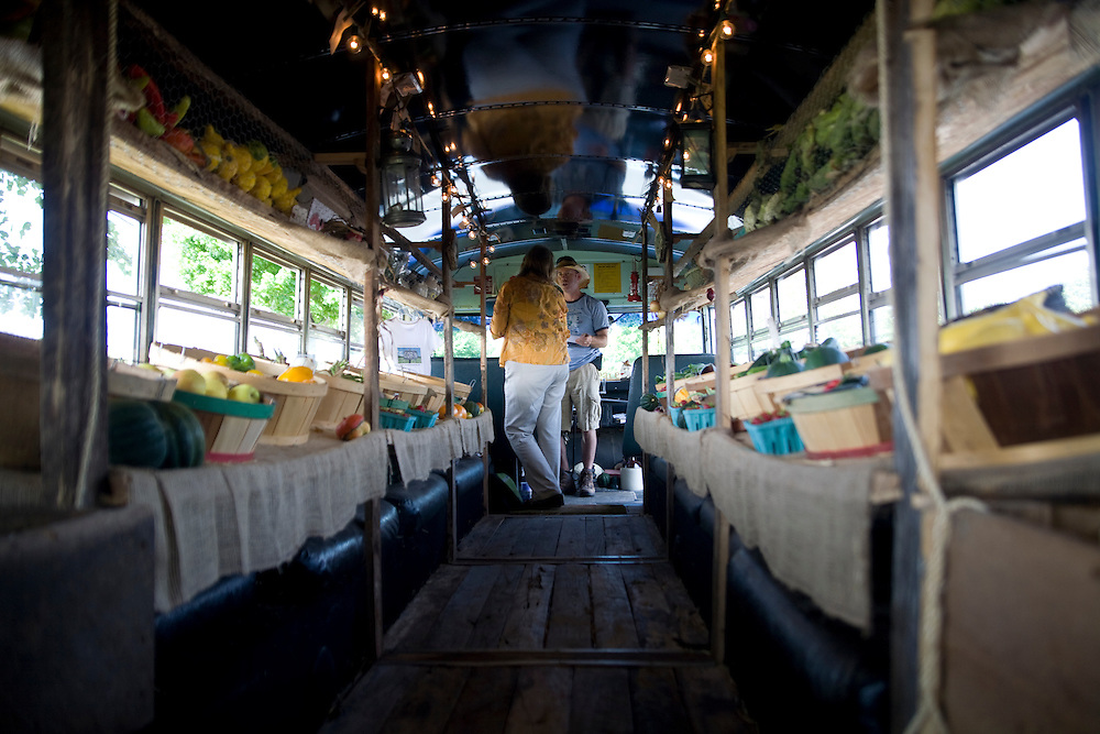 A view down the aisle of the Farm to Family Bus. The bus is operated by Mark and stops all over Richmond to provide produce to places that do not have access to local produce. He is currently working to take food stamp cards.