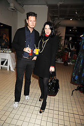 PERCY PARKER and AMY MOLYNEAUX at a party to celebrate the 2nd issue of Distill Magazine held at The Shop at Bluebrid, Kings Road, London on 1st December 2008.