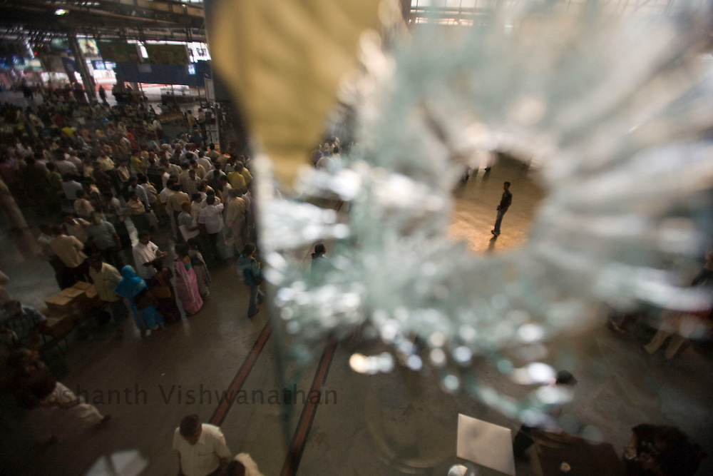 A bullet shattered glass is seen at a restaurant at the Chatrapathi Shivaji Terminus rail station where terrorists went on a shooting spree a week ago in Mumbai, on Tuesday, Dec. 2, 2008. The 60-hour killing spree by less than a dozen terrorists in   Mumbai last week underscores the failure of India's police force to keep pace with better armed, equipped and trained militants, a former intelligence agent said.