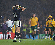 Scotland's Sean Maitland with his head in his hands after a really close game during the Rugby World Cup Quarter Final match between Australia and Scotland at Twickenham, Richmond, United Kingdom on 18 October 2015. Photo by Matthew Redman.