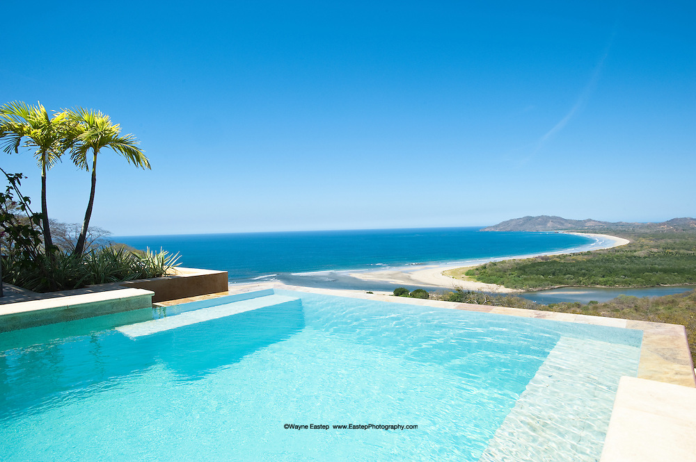 Villa infinity pool  overlooking Playa Grande beach, Pacific Ocean, Las Baulas National Marine Park and estuary, Tamarindo, Costa Rica