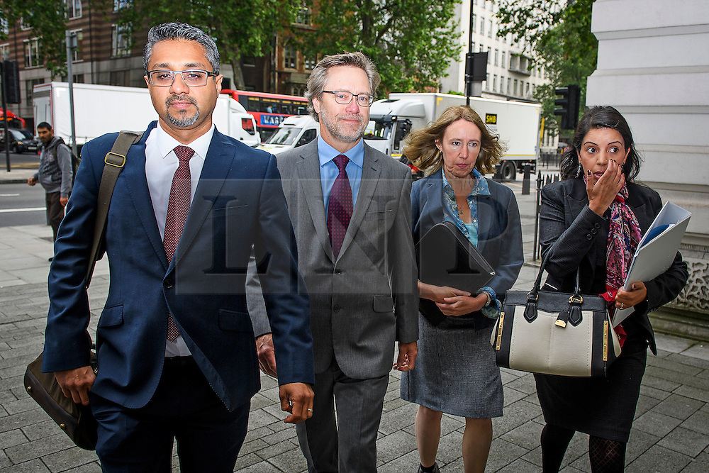 © Licensed to London News Pictures. 09/06/2016. London, UK. JOHN LETTS, (second left) and SALLY LANE (second right) arrive at Westminster Magistrates Court in London where they face terrorism charges. John Letts and Sally Lane are accused of trying to send money to their son, Jack Letts, AKA 'Jihadi Jack' who is suspected of supporting ISIS after he fled to Syria in 2014 aged 18.  Photo credit: Ben Cawthra/LNP
