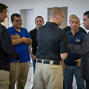 FORT LAUDERDALE, FLORIDA, DECEMBER 21, 2015<br /> Suspended Broward Sheriff's deputy Peter Peraza, right in suit, chats with supporters, mostly plain clothes police officers in a hallway of the Broward County Courthouse following a brief court appearance. Peraza faces manslaughter charges in the shooting death of Jermaine McBean, 33, in July of 2013.<br /> (Photo by Angel Valentin/Freelance).