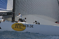 United Internet Team Germany prepares to hoist spinnaker during America's Cup fleet race; Valencia, Spain.