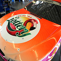Danica Patrick will drive the Florida Lottery/Go Daddy Chevrolet pair scheme during the 56th Annual NASCAR Coke Zero400 race at Daytona International Speedway. This garage image was taken on Thursday, July 3, 2014 in Daytona Beach, Florida.  (AP Photo/Alex Menendez)