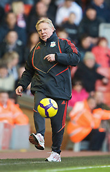 LIVERPOOL, ENGLAND - Saturday, January 30, 2010: Liverpool's assistant manager Sammy Lee plays a perfectly weighted pass into Bolton Wanderers' Matthew Taylor during the Premiership match at Anfield. (Photo by: David Rawcliffe/Propaganda)