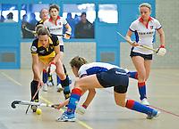 UTRECHT - Hoofdklasse Zaalhockey: Karin de Ouden van Den Bosch aan de bal tijdens de wedstrijd tussen de vrouwen van Den Bosch en SCHC.  FOTO KOEN SUYK