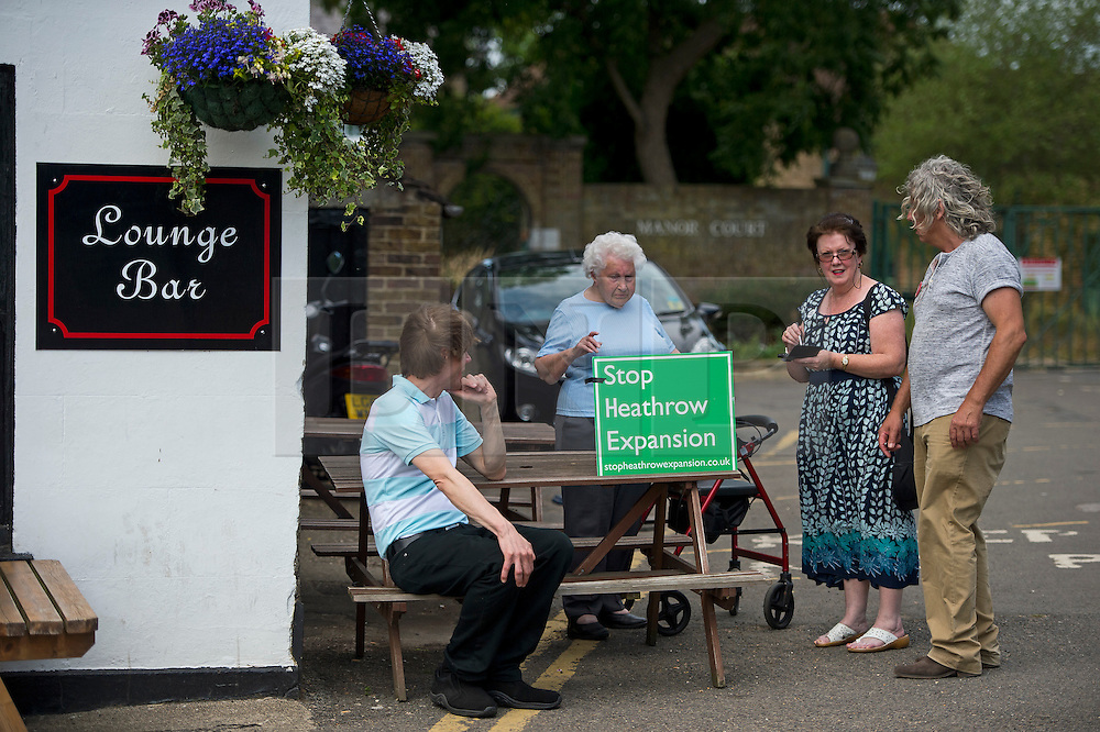 © London News pictures...  01/07/2015. Harmondsworth, UK. Stop Heathrow Expansion campaigners gather in the village of Harmondsworth in West London. Harmondsworth is due to be demolished to make way for a third runway at Heathrow Airport if plans go ahead. The airports commission today (Weds) gave it's backing for the £18.6bn plan for a third runway at Heathrow. Photo credit: Ben Cawthra/LNP