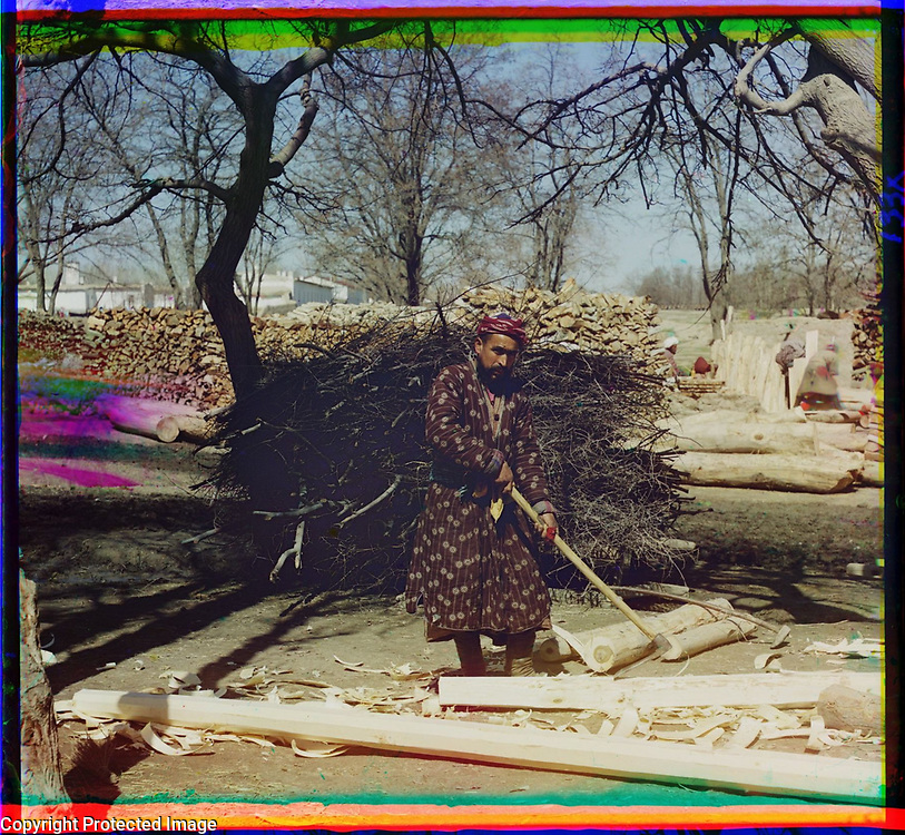 1905<br /> Shown in this winter view is a carpenter in a colorful padded robe using a long-handled adze to shape a log. A trimmed log in octagonal shape lies in the foreground. Behind the man are twigs and firewood stacked among gnarled plane trees. Visible on the right is another figure in a white turban. In the far left background is a white-stuccoed wall, probably built for the Russian compound in Samarkand. The image is by Russian photographer Sergei Mikhailovich Prokudin-Gorskii (1863&ndash;1944), who used a special color photography process to create a visual record of the Russian Empire in the early 20th century. Some of Prokudin-Gorskii&rsquo;s photographs date from about 1905, but the bulk of his work is from between 1909 and 1915, when, with the support of Tsar Nicholas II and the Ministry of Transportation, he undertook extended trips through many different parts of the empire. Prokudin-Gorskii was particularly interested in recently acquired territories of the Russian Empire such as Turkestan (present-day Uzbekistan and neighboring states), which he visited on a number of occasions, including a trip in January 1907 that focused on the ancient cities of Bukhara and Samarkand.  Turkestan appealed to him not only for its Islamic architecture but also for scenes from traditional life in cities such as Samarkand, taken by Russian forces in 1868.
