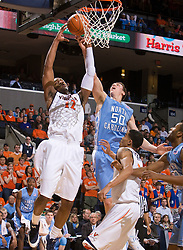 North Carolina forward Tyler Hansbrough (50) and Virginia forward Jamil Tucker (12) battle for a rebound.  The the #5 ranked North Carolina Tar Heels defeated the Virginia Cavaliers 83-61 in NCAA Basketball at the John Paul Jones Arena on the Grounds of the University of Virginia in Charlottesville, VA on January 15, 2009.