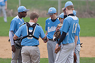 Goshen, New York - Sullivan West players meet on the pitcher's mound during a varsity baseball game on May 2, 2014.