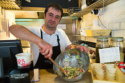 Chef Eddie Macit mixes a dressing at London's first totally vegan chippy in Hackney, North East London. Hackney, London, October 08 2018.