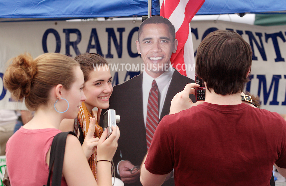 Goshen, NY - Three young people takes photographs of next to a life-size photograph of Democratic presidential candidate Barack Obama at the Great American Weekend festival on July 5, 2008.